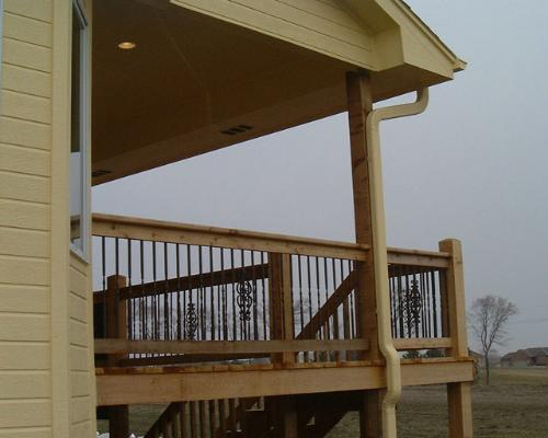Covered deck with metal railing